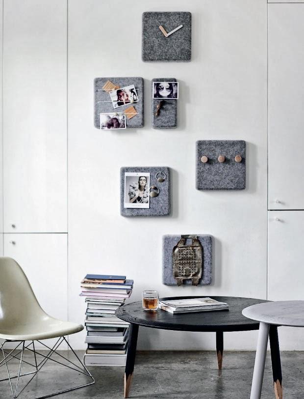 Un rincón de la vivienda decorado con elementos de fieltro, muebles de aire nórdico y armarios que se confunden con la pared.