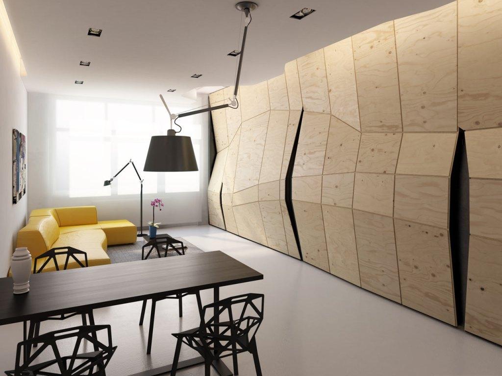 Zona del estar con la pared que esconde los secretos.